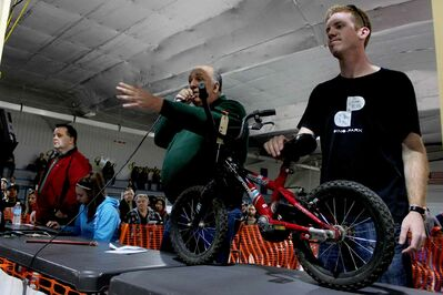 Hundreds of people packed into Varsity View Sportsplex early Saturday morning for City of Winnipeg's annual bike auction.