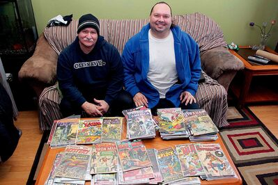 Maples Comics & Collectibles Show organizers Derek Gauthier (left) and Wally Dorvault show off just a fraction of their combined comic book collection.