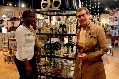 Gwen Repeta (right) and Esther Tchando, who works at Ten Thousand Villages after immigrating to Winnipeg from Benin in West Africa.