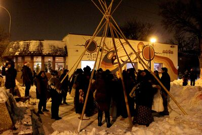 Attendees gather and sing songs during the Lighting up the Avenue event on  Dec. 5 on Selkirk Avenue.