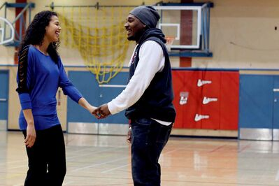 Tia Ruddock (left) proposed to her boyfriend of six years, Ramon Burke, during halftime at the last Wesmen women's basketball game of the year.
