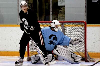 Raiders Jr. Hockey Club captain Jordan Lisowick and goalie Brenden Fiebelkorn have been instrumental in the team's turnaround this season.