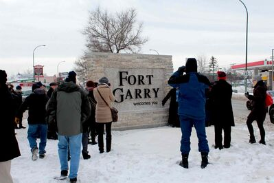 "Mayor Sam Katz, diginitaries and a handful of area residents braved the cold to attend the unveiling of the new ""Fort Garry welcomes you"" sign on Pembina Highway."