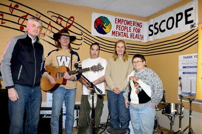 SSCOPE staff (from left) Bob Rempel, executive director; Marv Thiessen, operations supervisor; Craig Richardson, member employee and musician; Yvette Chartrand, customer care; Judy Ransome, food services employee.