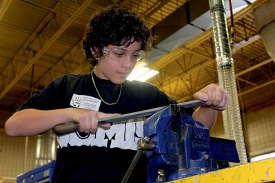 Kyler VandeMosselaer, a Grade 8 student at Van Walleghem School, works on a project in Winnipeg Technical College's motosports classroom during a day of hands-on experience for students in the Pembina Trails school division. (JORDAN THOMPSON)