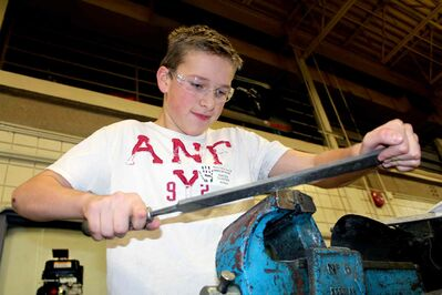 Hunter Cloutier, a Grade 8 student at Van Walleghem School, works on a project in Winnipeg Technical College's motosports classroom during a day of hands-on experience for students in the Pembina Trails school division. (JORDAN THOMPSON)