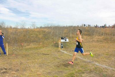 Belmin Mackie took first place in the Junior Varsity Boys category at the  MHSAA's Cross-Country Championships.