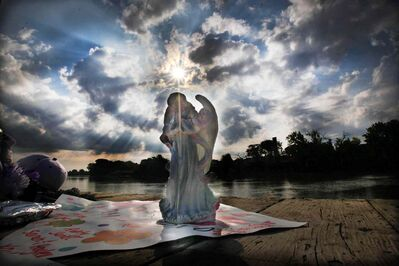 An angel sits on the Alexander Docks Wednesday morning after Tuesday night's vigil to remember Tina Fontaine and Faron Hall, whose bodies were pulled from the Red River.