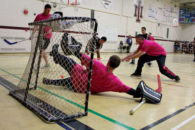 An Isaac Newton student rushes the net in a lunch time game against Winnipeg Police District 3 officers last week.