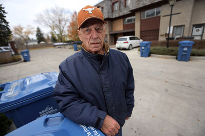 Westwood-area resident Bernard Palmer is angry about the new autobin recycling system. The scheduled pickup for his condo complex is Thursday, and as of 2 p.m. Sunday, the carts were still full.