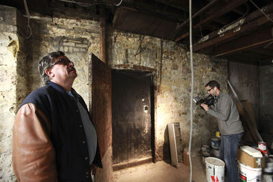 Local historian Randy Rostecki at the underground door in the basement of the Crocus building.