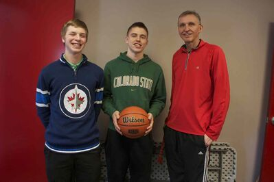 Mennonite Brethren Collegiate Insitute Hawks guards Matt Dyck and Derek McKnight are shown with head coach Jon Goossen.