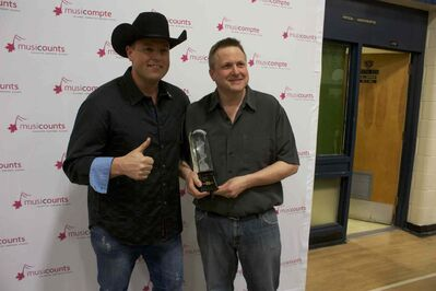River East Collegiate music teacher Jeff Kula (right) and country artist Gord Bamford are shown. Kula won the MusiCounts teacher of the year award on March 26.
