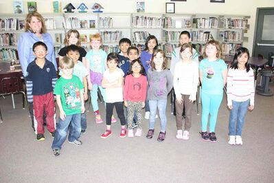 The 15 Sherwood School students who were randomly selected for a pizza party with the University of Manitoba's Spread the Net Student Challenge organizers and school principal Theresa Hunt are shown.