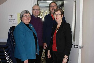 Rev. Carol Fletcher, Rev. Jeff Cook, Bob Buchanan, and Colleen Tackaberry are shown by the current elevator at Transcona Memorial United Church.