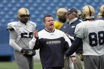 Cory McDiarmid, seen her with the Blue Bombers in 2007, returns to the team as linebacker coach.