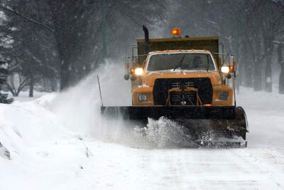 Crews will start plowing main routes, bus routes and collector streets, and a parking ban on snow routes will be in effect between midnight and 7 a.m.