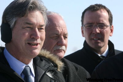 Premier Gary Doer (from left), senior Manitoba MP Vic Toews and provincial conservative leader Hugh McFadden touring southern Manitoba today.