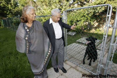 Vydha Dominique and Dr. Francis Dominique with their two-year-old German shepherd, Tara. The couple alleges racial taunts.