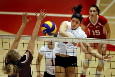 Wesmen's Lauren Sears slams a spike over the net. Sears was named an athlete of the month.