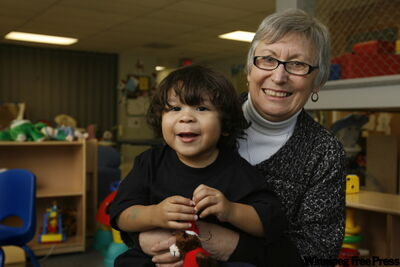 Pregnancy and Family Support Services director Carol Clark holds Tavian Parenteau, one of many kids at the daycare.