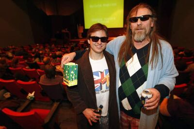 Winnipeggers attend a screening at Lebowskipalooza.