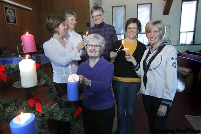 Alumni members of Canadian Girls In Training at Harrow United Church. From left: Nancy Wilson, Teresa Moysey, Nancy Saunders (plaid), Lesley Harrison, Karen Ilchena (uniform) and Pat Finlayson (front).