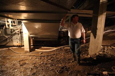 School division official Glynn Warnica watches water seep into Wawanesa school basement.