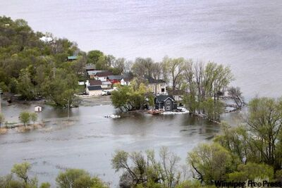 Property damage from flooding of Lake Manitoba can be seen from the air in the Delta Beach area.