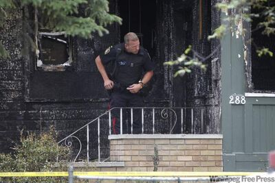 Police at the scene of the house fire on Austin Street North which claimed the lives of five people in July 2011.