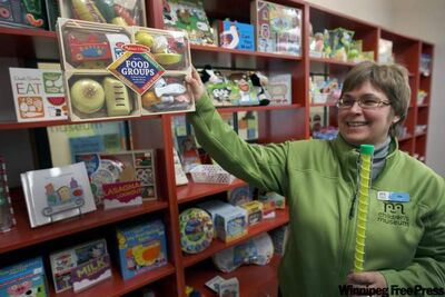 Joy Ayre from the Children's Museum shows off toys that passed muster this year.