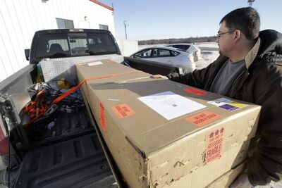 Warren Doerksen from Morris, MB, picked up a 10-foot long piece of exercise equipment at Pembina Parcel in Pembina, ND.
