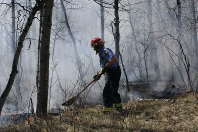 A lack of hydrants forced crews to haul hoses into the forest to fight a fire near the Canadian Mennonite University campus.