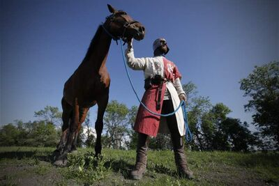 Vincent Kirouac with his horse, Coeur de Lion, in Elie. He's travelling across the country on horseback to promote chivalry.