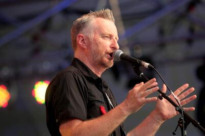 Billy Bragg performs on the Main Stage at the 39th annual Winnipeg Folk Festival at Birds Hill Park in July 2012.