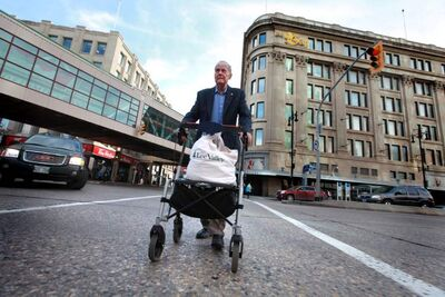 John Clark, 87, uses a walker to take groceries home from the downtown Zellers, which is closing.