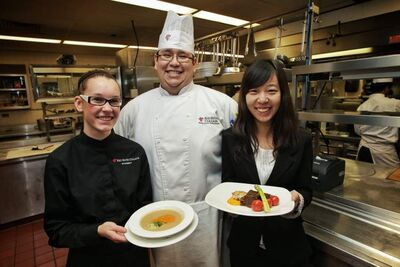 From left, server Hayley McMurray, 19, daily chef Shane Morris, 28, and host Xinyuan Cai, 19, inside the kitchen at Prairie Lights restaurant.