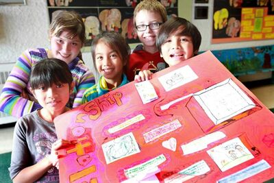 Margaret Park School students (front, from left) Samantha Froilan, Juliet Garcia, Joaquin Comia and (back row)  Rozel Averbuch and Cameron Jones show a project relating to treaties between Europeans and aboriginals.