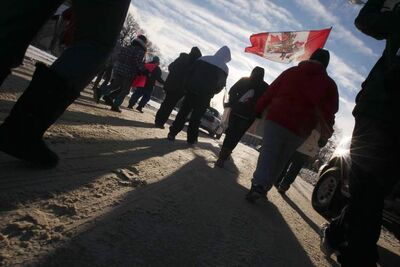 Idle No More protesters headed up Memorial Boulevard towards the Manitoba Legislative Building Wednesday morning.