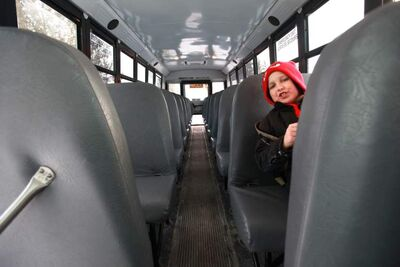 Reynolds Grade 5 student Devon Nazor, 9, has his pick of seats on the school bus. He says when he was in kindergarten, 'there were like 40' kids at the school.