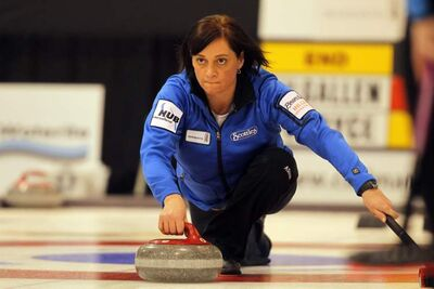 Colleen Kilgallen curls in the Scotties Tournament of Hearts Friday.  Kilgallen scored a deuce in the ninth end Saturday morning and then stole two more in the tenth end to nip Karen Fallis 9-8 and finish first overall with a 6-1 record.