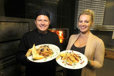 Santa Ana owner Darek Wozny and wife Debbie Wozny with Fungi Linguine and Mediterranean shrimp