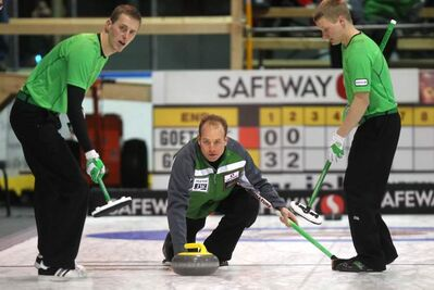 Sean Grassie throws as sweepers Stu Shiells (left) and Kody Janzen take the rock  Wednesday afternoon at the Safeway Championship in Neepawa.
