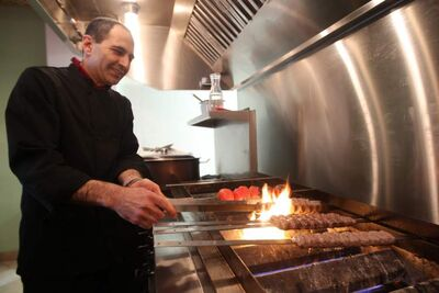 Owner Farhad Sultanpour makes kabobs at Kabob Palace.