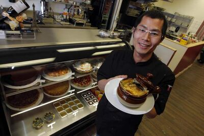 Owner/pastry chef Cam Tran with French onion soup.