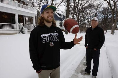 The Winnipeg Blue Bombers have signed punter Brett Cameron to a training camp roster; Cameron is the son of legendary Bomber punter Bob Cameron
