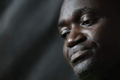 Willy Halisi, father of 10-year-old Ashuza who died after having hernia surgery, contemplates a reporter's question during an interview in his family home in Winnipeg, March 17.  The medical examiner has ruled Ashuza's death accidental.