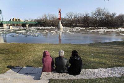 Winnipeggers check out the high water levels at The Forks on Sunday.  The Red is expected to crest in Winnipeg between 17.8 and 20.5 feet James later in May.