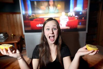 Kirsten Kettler can split an apple in half with her head. Her video of the stunt could earn her $10,000.