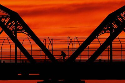 A cyclist crosses the Arlington Street Bridge. The bridge will close from July 15 to Aug. 31 for repairs.